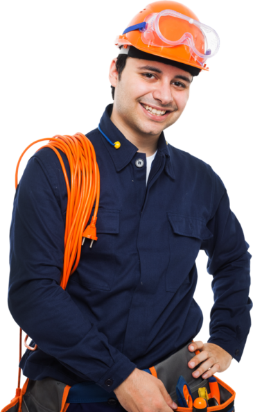 Smiling Hardie team member wearing a hardhat including safety goggles, with extension cord slung over his shoulder, while grabbing a tool from his tool belt.
